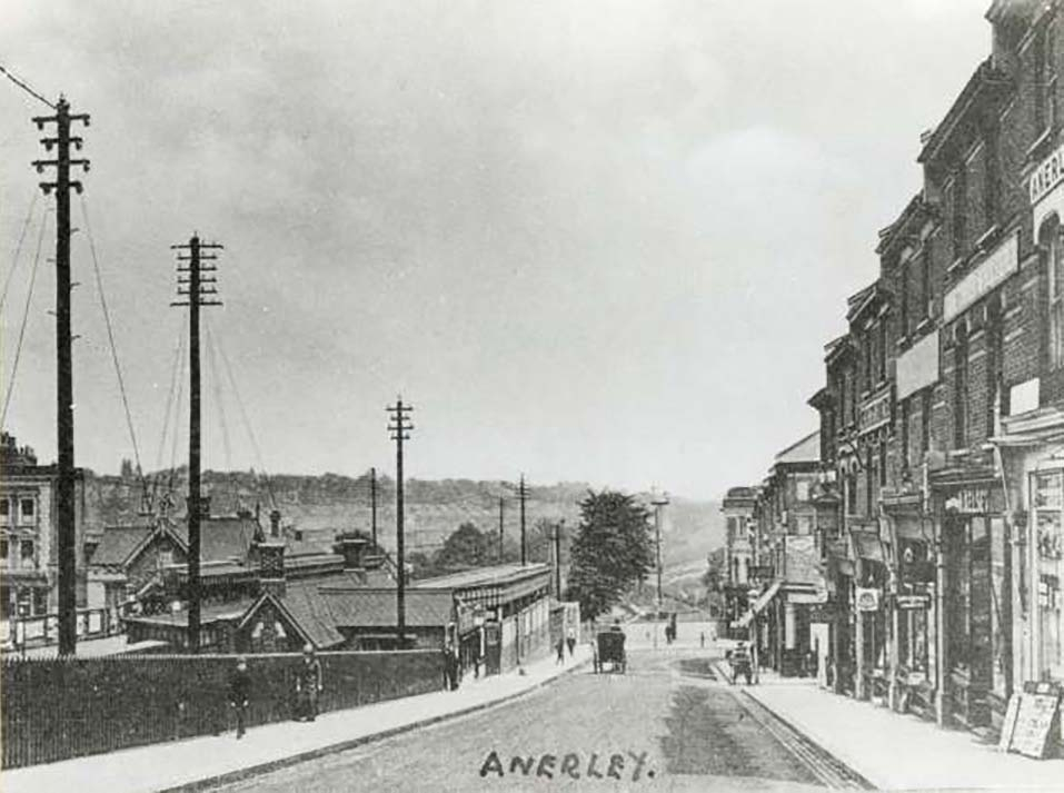 black and white photograph showing a street scene of Anerley Station Road